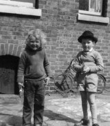 Me and gun-slinging neighbour kid, outside 30 Princes Road, Stockport, 1964.