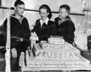 David cutting a cake with Russian soldiers.